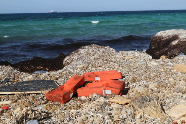 Life jackets washed up on the shore are pictured near a route frequented by migrants trying to cross the Mediterranean, near the coastal town of Zuwara, west of Tripoli